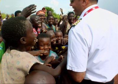 Congo Bush Pilot greeting children